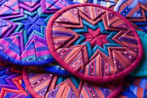 Guatemala, Antigua. Colorful quilt pieces for sale in shop in Antigua. by Julie Eggers