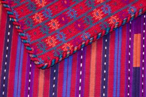 Guatemala, Antigua. Colorful weavings for sale in shop in Antigua. by Julie Eggers