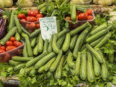 Italy, Florence. A variety of vegetables for sale in a shop in the Central Market, Mercato Centrale