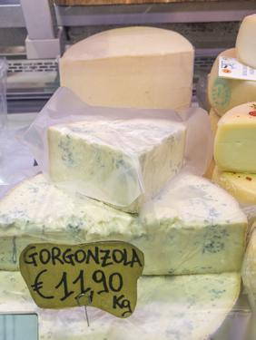 Italy, Florence. Blocks of gorgonzola cheese for sale in the Central Market, Mercato Centrale by Julie Eggers