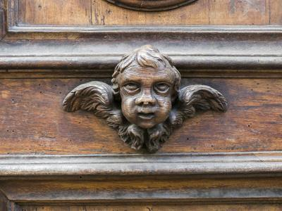 Italy, Florence. Carved ornament on a door in Florence.