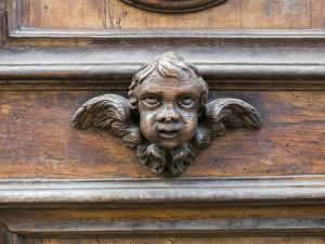 Italy, Florence. Carved ornament on a door in Florence. by Julie Eggers