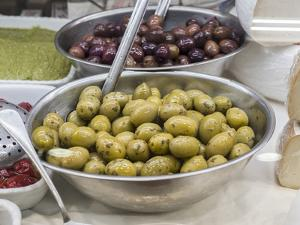 Italy, Florence. Dishes of olives in the Central Market, Mercato Centrale in Florence. by Julie Eggers