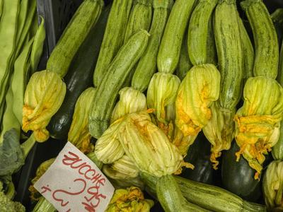 Italy, Florence. Zucchini with flowers for sale in the Central Market, Mercato Centrale in Florence