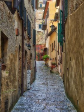 Italy, Tuscany. A narrow street scene in a village in Tuscany. by Julie Eggers