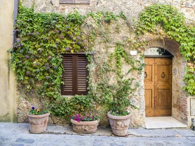 Italy, Tuscany. Entrance to a home in Tuscany decorated with potted plants.