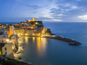 Italy, Tuscany. Hillside town of Vernazza in the evening, Cinque Terre, Liguria region, Italy by Julie Eggers