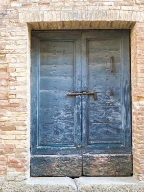Italy, Tuscany. Old blue door with iron latch in a village in Tuscany. by Julie Eggers