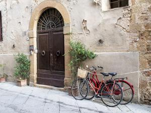 Italy, Tuscany, Pienza. Bicycles Parked Along the Streets of Pienza by Julie Eggers
