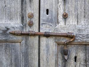 Italy, Tuscany. Unique metal door lock on an old wooden door. by Julie Eggers