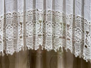 Netherlands, Amsterdam. Lace curtains very typical in Amsterdam homes. by Julie Eggers