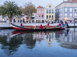 Portugal, Aveiro. Moliceiro boat on the canal. by Julie Eggers