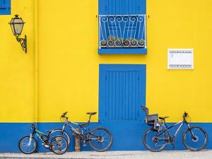 Portugal, Aveiro. Yellow house with blue shutters, windows and doors in the city of Aveiro. by Julie Eggers