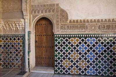 Spain, Andalusia, Alhambra. Ornate door and tile of Nazrid Palace. by Julie Eggers