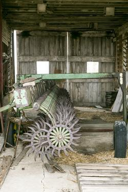 Antique Plow in an Old Wooden Barn, Joliet, Illinois, USA. Route 66 by Julien McRoberts