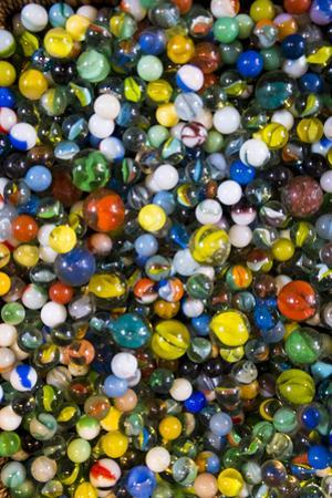 Pile of glass marbles, Williamsburg, Brooklyn, New York, Usa. by Julien McRoberts