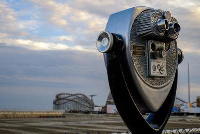 Tourist telescope looking out at an amusement park, Wildwood, New Jersey, Usa by Julien McRoberts