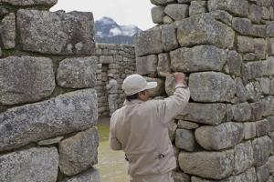 Restoration work at the Inca ruins of Machu Picchu, UNESCO World Heritage Site, Peru, South America by Julio Etchart