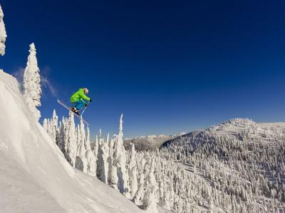 https://imgc.allpostersimages.com/img/posters/jumping-from-cliff-on-a-sunny-day-at-whitefish-mountain-resort-montana-usa_u-L-PXQ9B40.jpg?artPerspective=n
