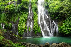 Jungle Waterfall Cascade in Tropical Rainforest with Rock and Turquoise Blue Pond. its Name Banyuma
