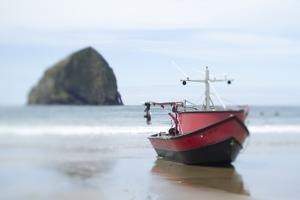 Dory Boat in Pacific City, Oregon by Justin Bailie