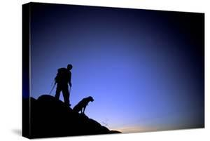Man and Dog Backpacking Near Lake Tahoe, California by Justin Bailie