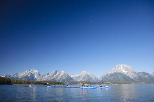 Sea Kayaking Jackson Lake In Grand Teton National Park, WY by Justin Bailie