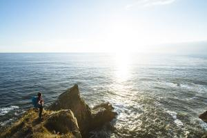 Young Woman Backpacking The Oregon Coast Trail. Oswald West State Park, OR by Justin Bailie