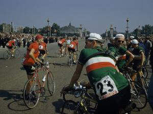 Athletes from Many Countries Await the Start of the Tour De France by Justin Locke
