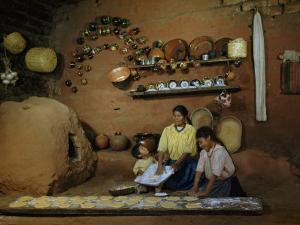 Family Prepares Tortillas Beside an Adobe Beehive-Shaped Oven by Justin Locke