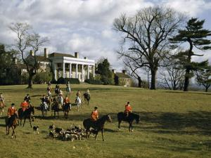 Fox Hunters on Horseback and Hounds Amble across Mansion's Front Lawn by Justin Locke