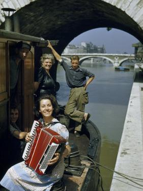 Playing and Listening to an Accordion, a Barge Family Relaxes by Justin Locke
