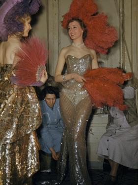Seamstresses Adjust Performers' Costumes Backstage at Folies Bergere by Justin Locke