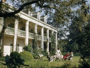 Servant Brings Tea to Women Seated on Lawn Outside Plantation House by Justin Locke