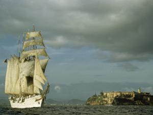Spanish Training Ship Leaving San Juan Sails Past El Morro at Sunset by Justin Locke