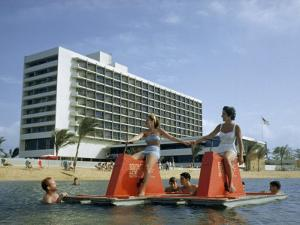 Tourists Pedal Raft Pass Swimmers at Oceanside Resort by Justin Locke