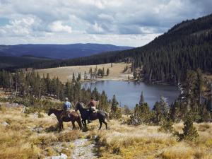 Two Horsemen Ride Above Pecos Baldy Lake by Justin Locke
