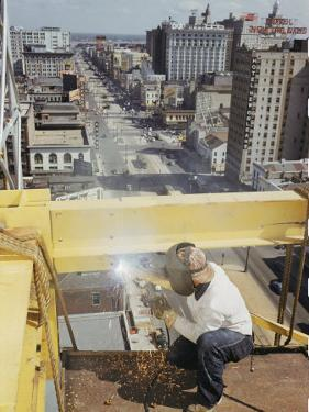 Welder Working on the Construction of a New Building by Justin Locke