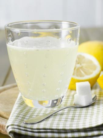 Hot Lemon with Sugar Cubes, Lemons in Background by Kai Schwabe