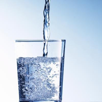 Pouring Water into a Glass by Kai Schwabe