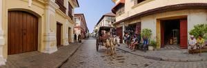 Kalesa moving along Calle Crisologo, Vigan, Ilocos Sur, Philippines