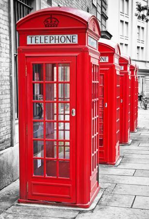 Row of Iconic London Red Phone Cabins by Kamira