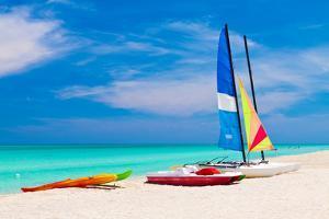 Sailing Boats, Catamarans, Kayaks and Water Bikes in the Beautiful Cuban Beach of Varadero by Kamira