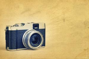 Vintage Rangefinder Style Camera on a Textured Background with Space for Text by Kamira
