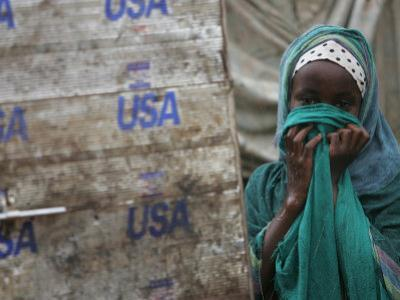 A Somali Child Covers Her Face at Dadaab Refugee Camp in Northern Kenya Monday, August 7 2006