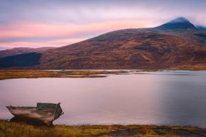 Lone boat on the Isle of Mull, Inner Hebrides, Scotland, United Kingdom, Europe by Karen Deakin