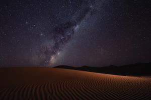 Milky Way rising over the sand dunes of Sossusvlei, Namibia by Karen Deakin