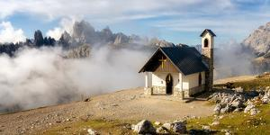 Small church with the Cadini di Misurina mountain range in the background, Dolomites, Italy by Karen Deakin