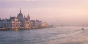 The Hungarian Parliament at sunset, Danube River, Budapest, Hungary by Karen Deakin