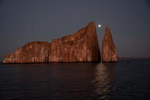 Moonrise Above Sleeping Lion in the Galapagos by Karen Kasmauski